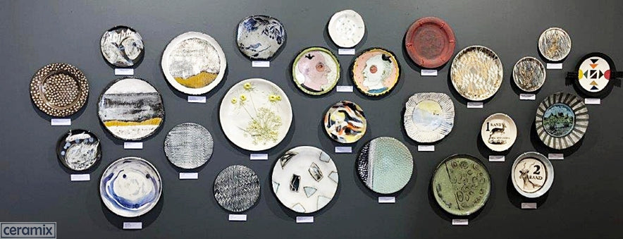 Wall of Plates at the Corobrick National Ceramics Biennale featuring a Ceramix Stoneware Platter.