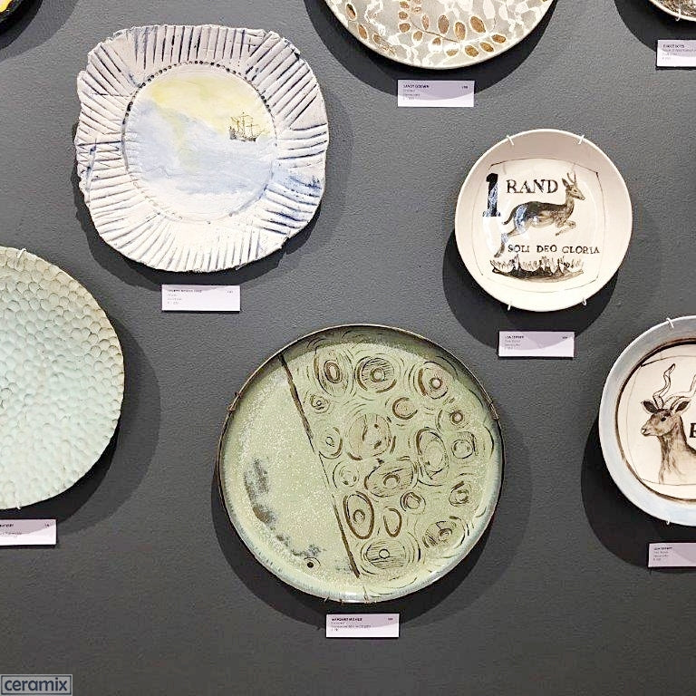 Wall of Plates at Rust-en-Vrede Gallery featuring a Ceramix Platter