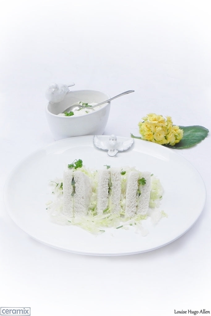 English Cucumber Sandwiches Served on a Ceramix Dove Plate. Handmade South African Ceramics.