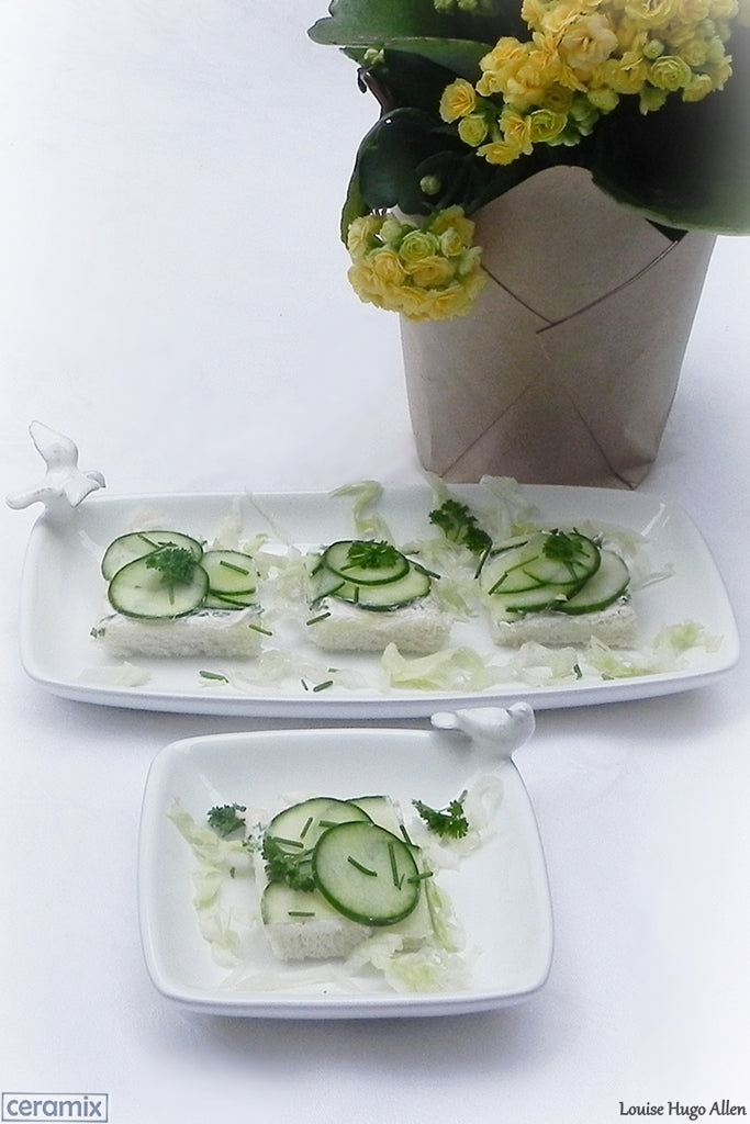 Open Square Cucumber Sandwiches with Cream Cheese served on Dove Plates by Ceramix. Handmade ceramics at a pottery in South Africa.