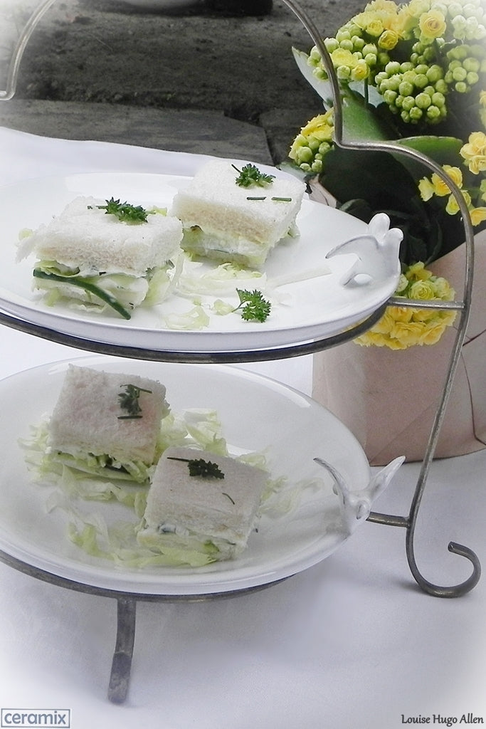 Square Cucumber Sandwiches with Cream Cheese served on Round Dove Plates. Ceramics handmade at a Pottery in South Africa.