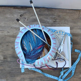 Abstract Turquoise with pink and purple drips Yarn Bowl in use photographed from above by Ceramix
