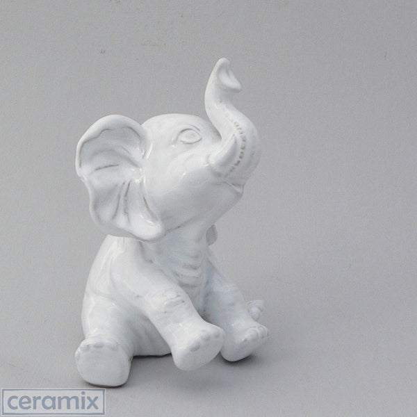 Ceramic Baby Elephant made from terracotta clay and glazed white.