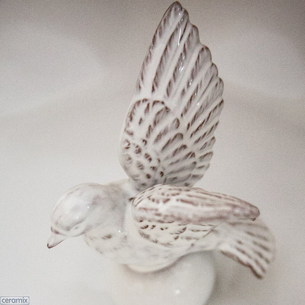 White Dove Flying on the Wavy Platter by Ceramix. Handmade in South Africa from African Terracotta Clay & glazed White.