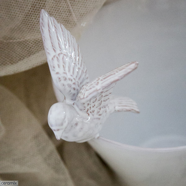 Flying Dove on Deep Bowl. Handmade at Ceramix in South Africa from Terracotta Clay glazed White.