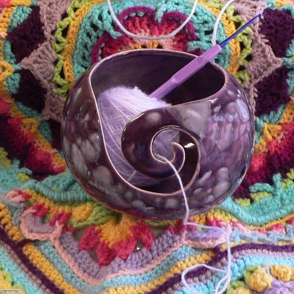 Bright crocheted blanket and the Paradiso Purple Small Round Yarn Bowl Handmade by Ceramix