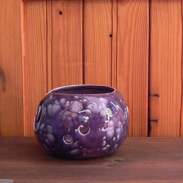 Paradiso Purple Small Round Yarn Bowl side view with 2 holes for knitting needles Handmade by Ceramix