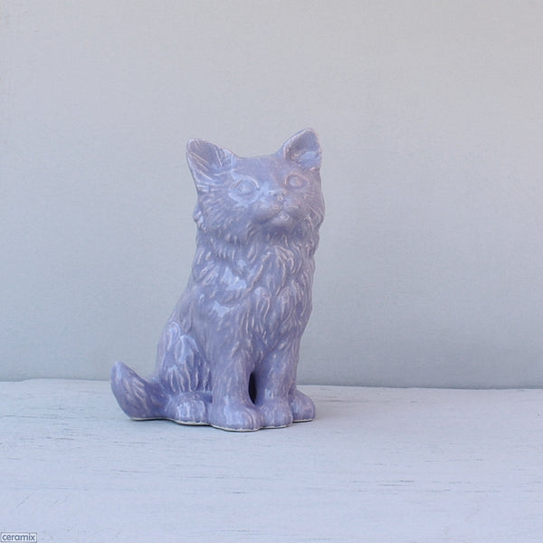 Purple Lily Sitting ceramic Cat. Handmade at the Ceramix pottery in South Africa from African clay.