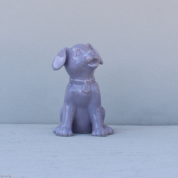 Purple Lulu Sitting Ceramic Dog. Handmade at the Ceramix pottery in South Africa from African clay