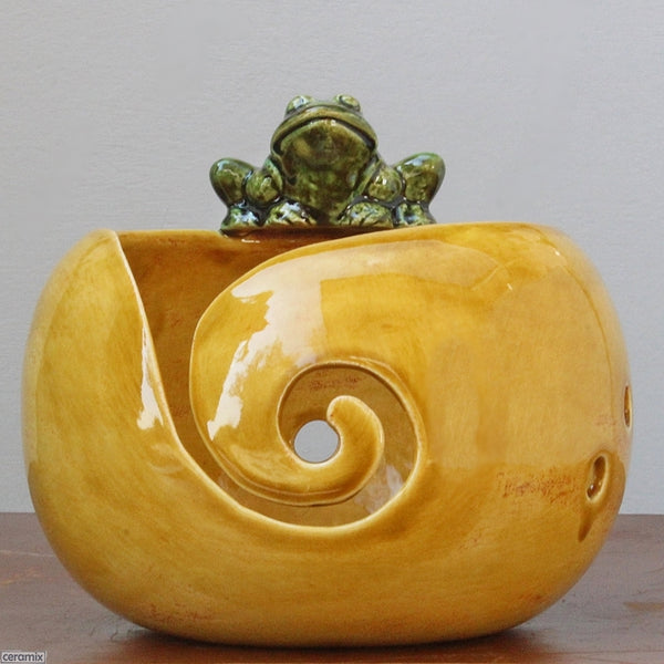 Handmade Saffron Yarn Bowl with green frog front view by Ceramix