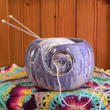 Sugilite Purple Large Round Yarn Bowl with knitting needles and wool on a crocheted blanket Handmade by Ceramix