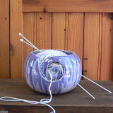 One of a Kind Sugilite Purple Large Round Yarn Bowl shown with wool and knitting needles Handmade by Margaret Melville Hugo from African clay and speciality glazes at Ceramix