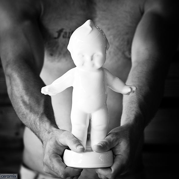 White Kewpie on Round Base in Terracotta Clay glazed White. Handmade in South Africa by Ceramix.