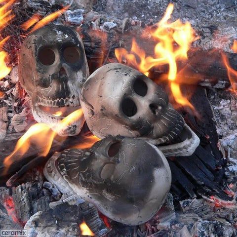 Zombie Skull Heads in the fire by Ceramix.co.za