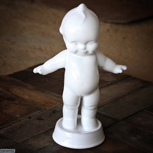 White Ceramic Kewpie in Terracotta Clay. Handmade in South Africa by Ceramix.