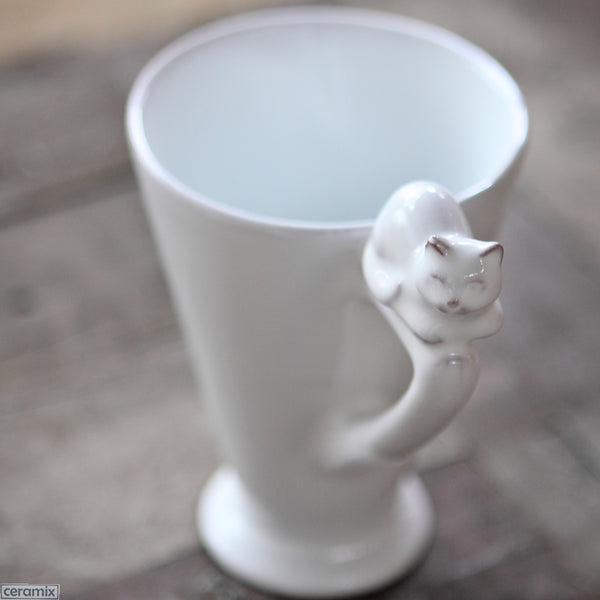 Lying Cat Mug with Triangle Handle. Handmade by Ceramix in South Africa from African Terracotta Clay & White Glaze.