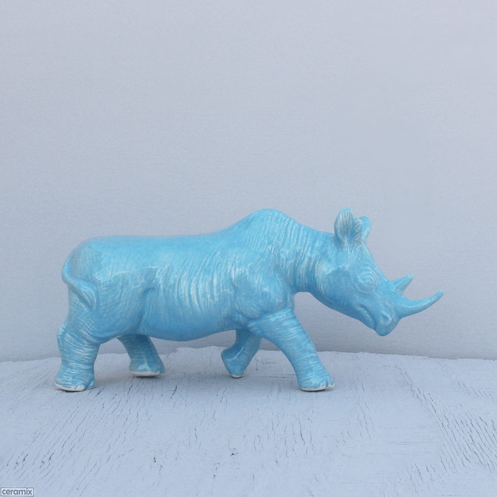 Turquoise glazed Black Rhino decor item. Handmade from African clay at the Ceramix pottery in South Africa.