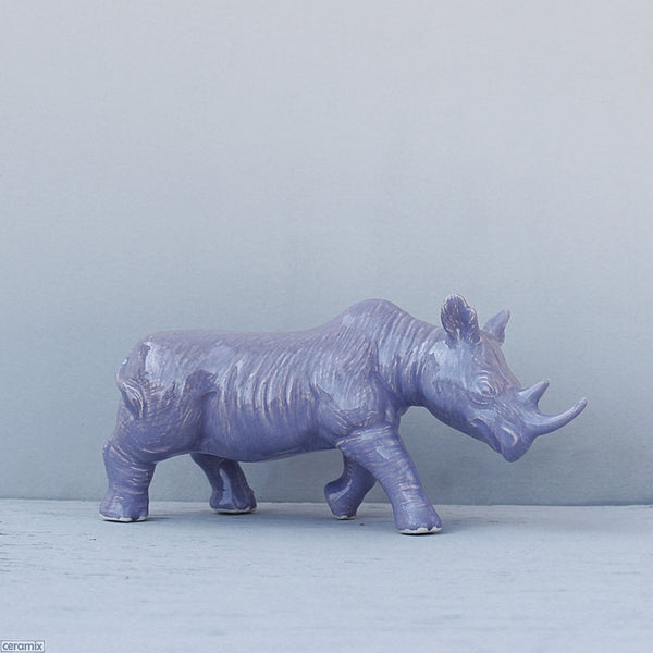 Purple glazed ceramic Black Rhino decor item. Handmade from African clay at the Ceramix pottery in South Africa.