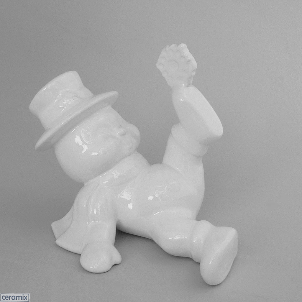 White Ceramic Lying Snowman with a Snowflake on his Foot by Ceramix