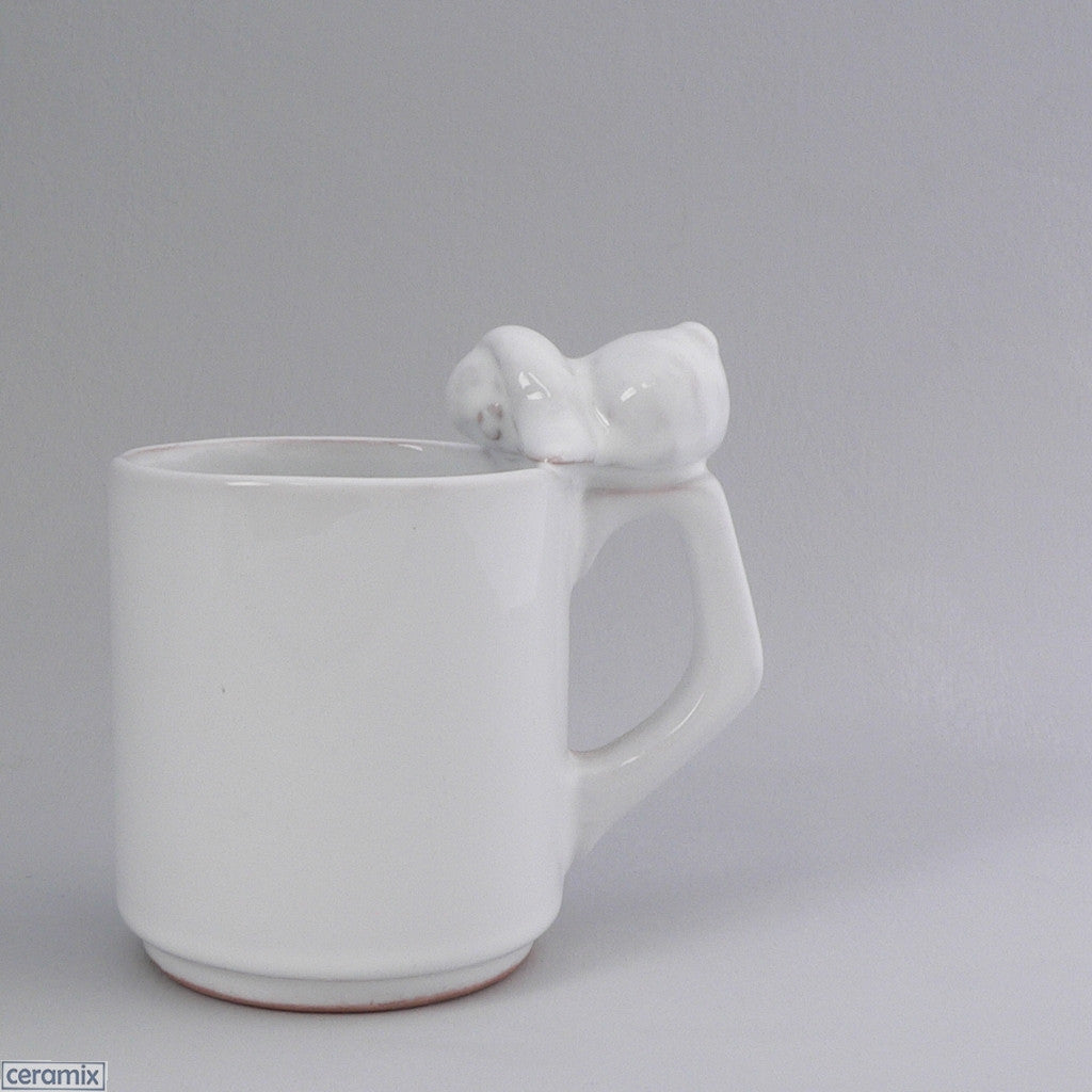 Sleeping Bunny Ceramic Mug handmade by the Ceramix Pottery in South Africa from African Terracotta clay & glazed white.