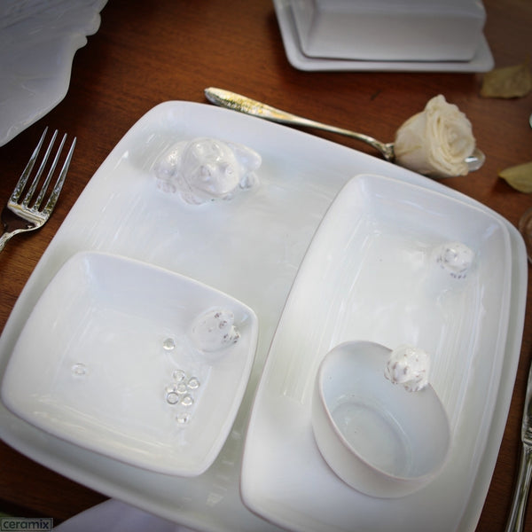 Tablescape which includes the White Ceramic Frog Square Plate in Terracotta Clay Glazed White by Ceramix
