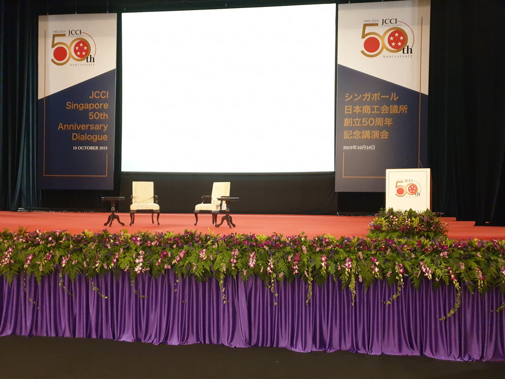 stage decoration with flowers and curtain at NUS