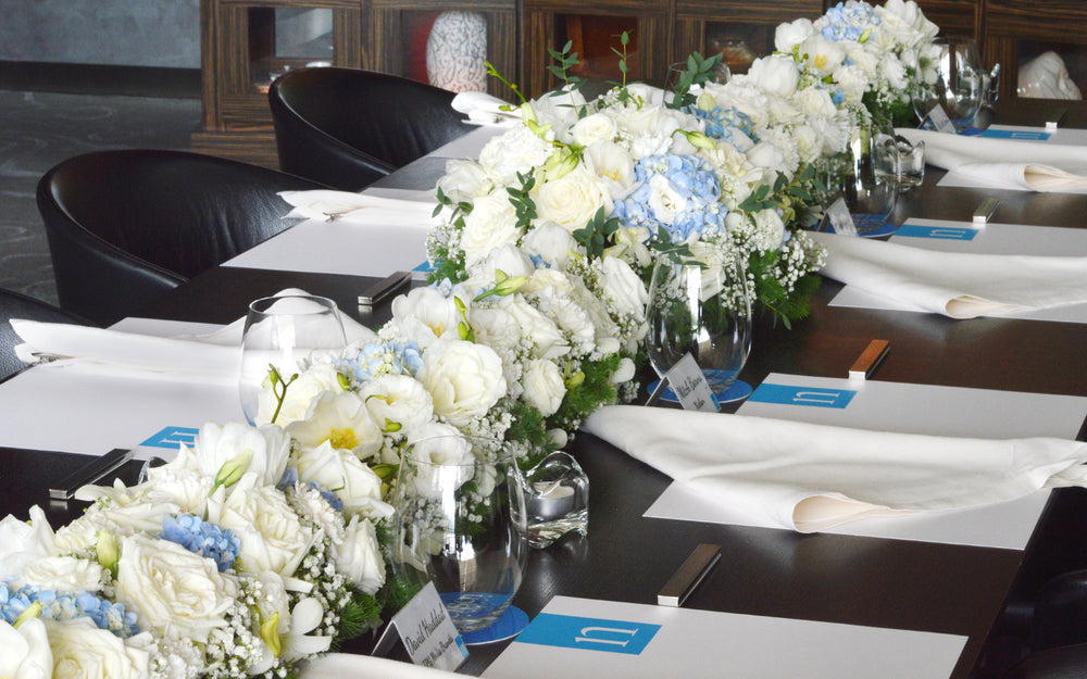 flowers in white and blue table arrangement