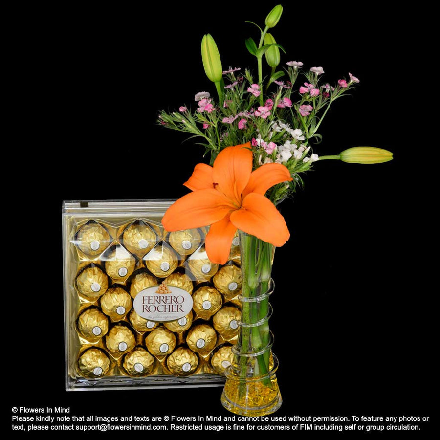 Ferrero Rocher T-24 with Lilies in Vase (HP287) - Flowers In Mind