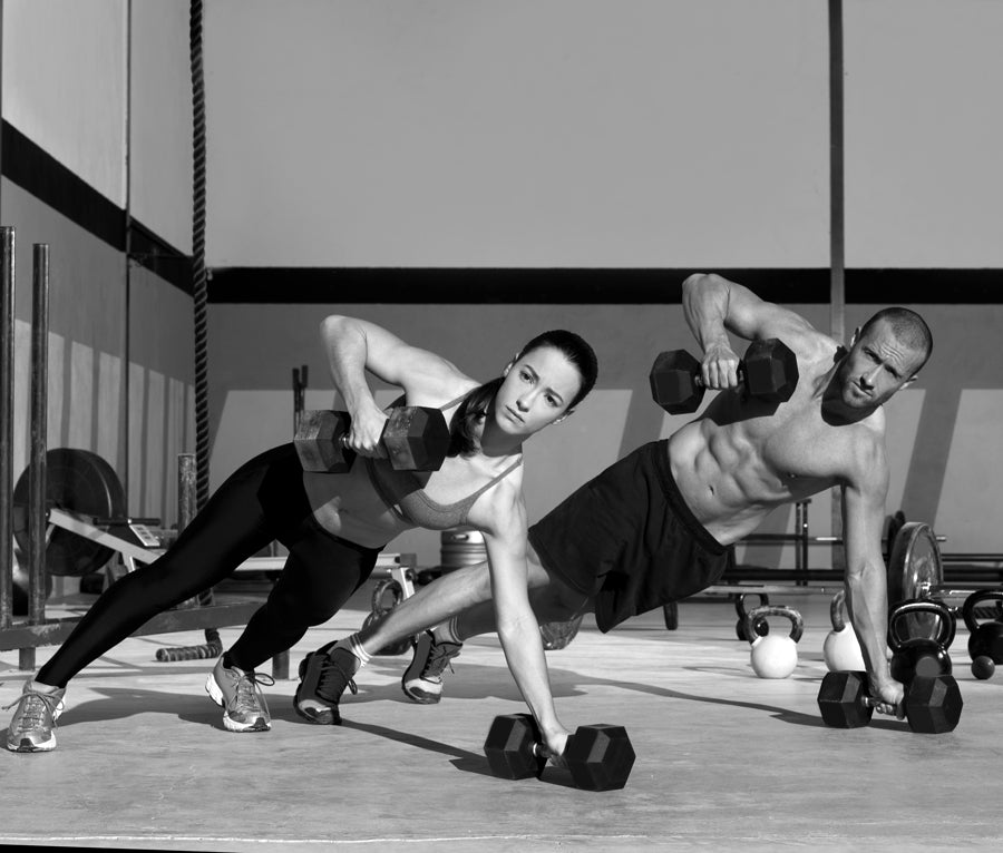 man and woman doing cross training exercises