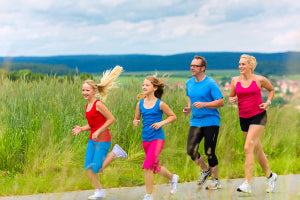 Family - mother, father and four children - doing jogging or out