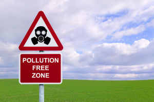 Image of a sign for a 'Pollution Free Zone' against a green fiel