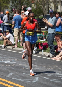 Jeptoo (Kenya) races up Heartbreak Hill during the Boston Marath