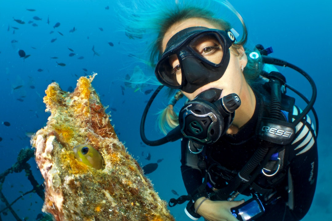woman using scuba diving gear underwater