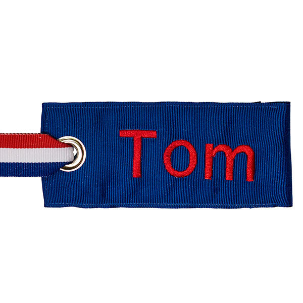 Personalized blue luggage tag with red text from YourBagTag