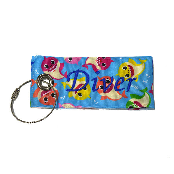Fabric Luggage Tag - bright blue with colored shark characters