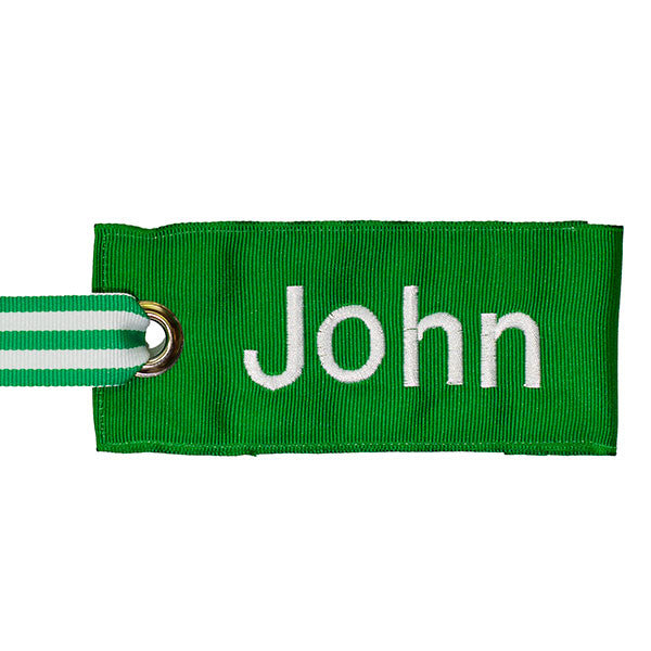 green fabric bag tag with white text from YourBagTag
