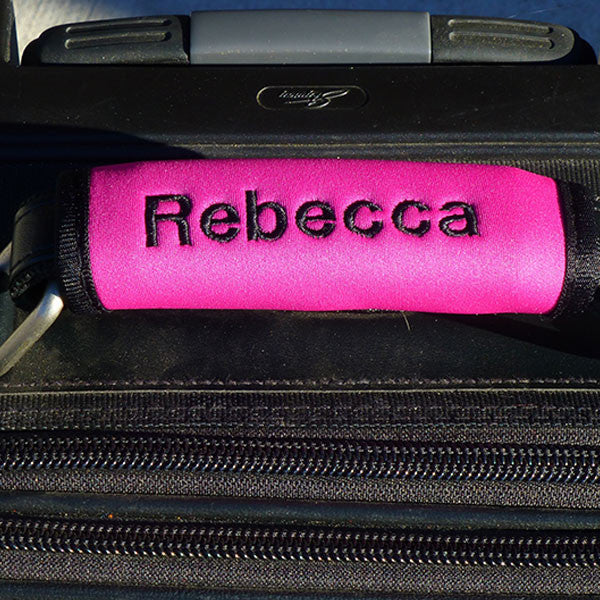 Pink custom luggage handle wrap from YourBagTag.com