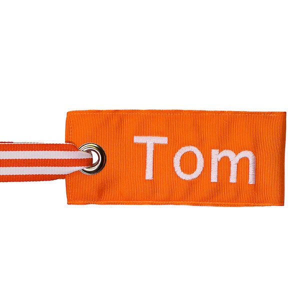 orange bag tag with orange-white stripe handle