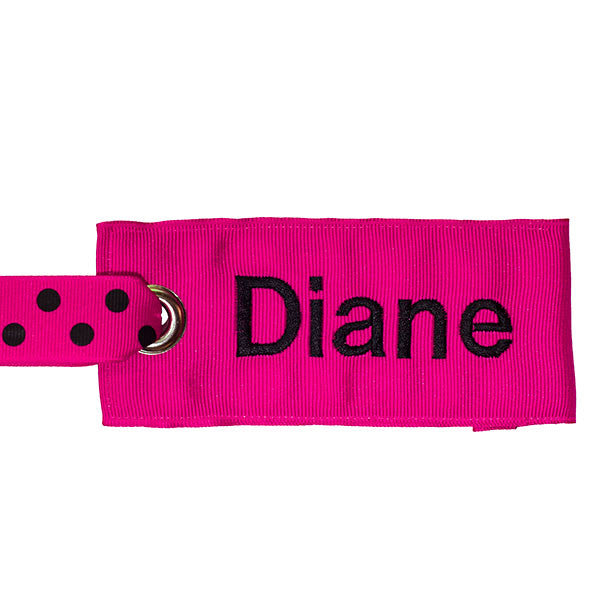 pink luggage tag with black text from YourBagTag