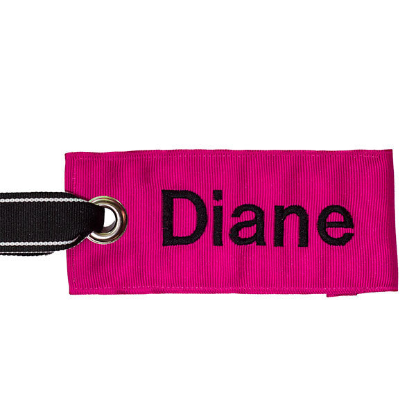 personalized pink bag tag with black text from YourBagTag