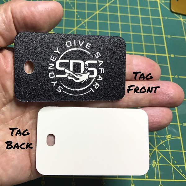 black plastic luggage tag shown front and back of tag