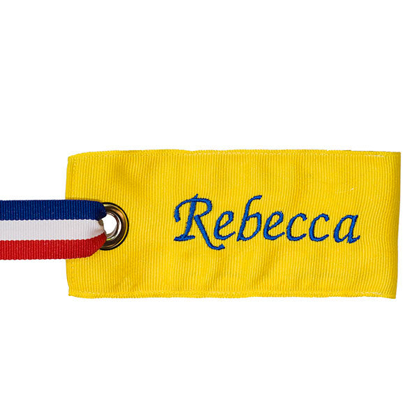 Bright yellow bag tag with personalized name