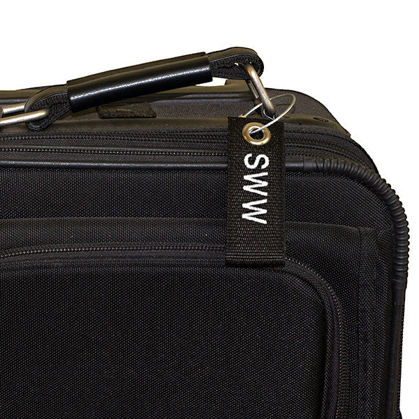 black mini extreme luggage tag shown on suitcase