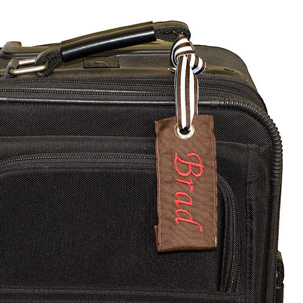 Brown Luggage tag shown black suitcase YourBagTag