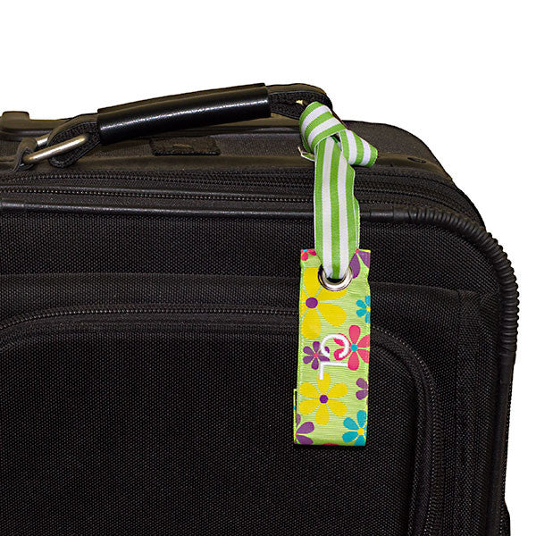 mini luggage tag flower print shown on suitcase
