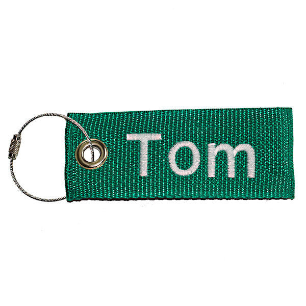 green extreme luggage tag with white text from YourBagTag