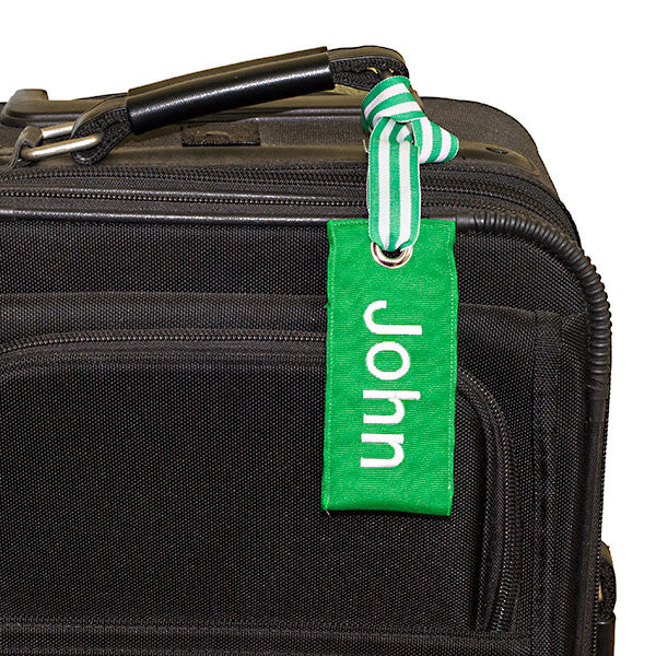 personalized green luggage tag shown on suitcase