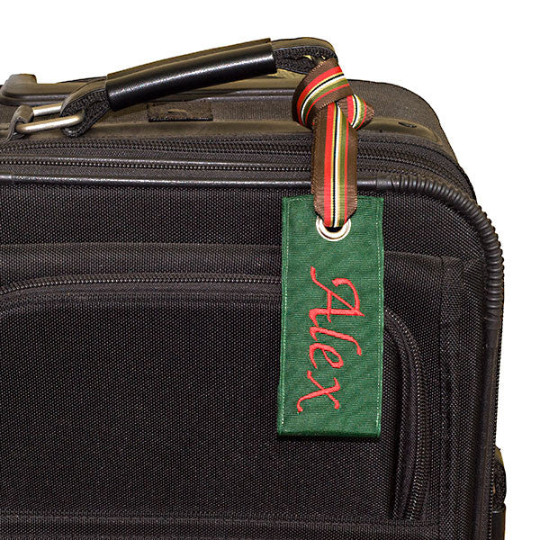 Personalized Hunter Green Luggage Tag shown on suitcase