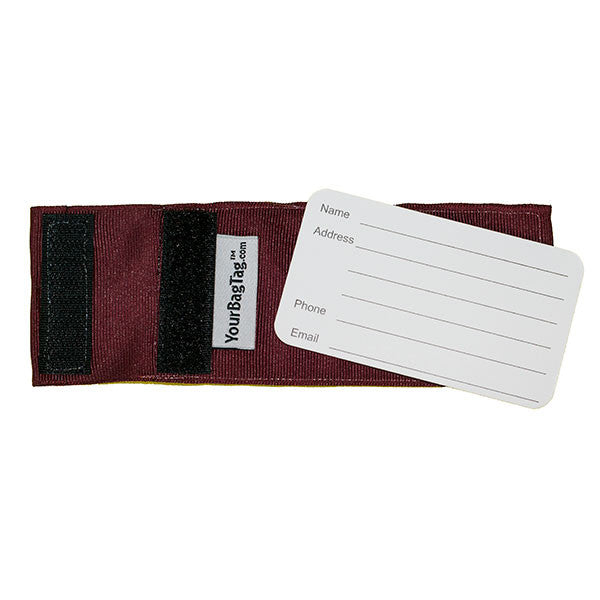 back of maroon luggage tag showing address card insert
