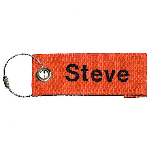 orange extreme luggage tag with black text from YourBagTag